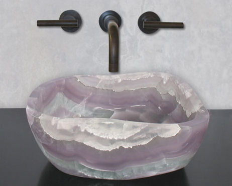 terra acqua miramar sink is cut from a single stone - kitchann style
