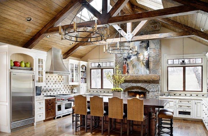 stone firepalce focal point of kitchen   KitchAnn Style